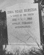 This headstone was purchased by Alice Walker after she found Hurston's unmarked grave in an overgrown and snake infested cemetery. Walker later published an essay about it in Ms magazine, leading to something of a renaissance in Hurston's reputation. Photograph by Alan Anderson.